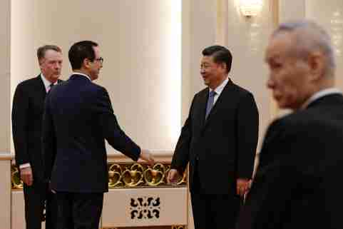 U.S. Treasury Secretary Steven Mnuchin, second from left, talks with Chinese President Xi Jinping as U.S. Trade Representative Robert Lighthizer, left, and Chinese Vice Premier Liu He, right, look on before their meeting at the Great Hall of the People in Beijing, China February 15, 2019. Andy Wong/Pool via REUTERS - RC1AFFB71800