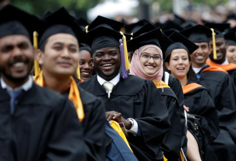 Graduating students of the City College of New York sit together in their caps and gowns as they listen to U.S. first lady Michelle Obama's address during the College's commencement ceremony in the Harlem section of Manhattan, New York, U.S., June 3, 2016. REUTERS/Mike Segar - D1BETHVBVCAA