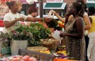 Customers shop for produce at the Food Project's Farmer's Market in the Boston neighborhood of Dorchester, Massachusetts August 14, 2007. Each year The Food Project hires 60 youth to grow food on their farms