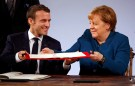 German Chancellor Angela Merkel and French President Emmanuel Macron sign a new agreement on bilateral cooperation and integration, known as Treaty of Aachen, in Aachen, Germany, January 22, 2019. REUTERS/Wolfgang Rattay - RC1184860E00