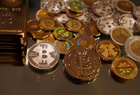 Bitcoins created by enthusiast Mike Caldwell are seen in a photo illustration at his office in Sandy, Utah, September 17, 2013. Caldwell produces physical coins Bitcoins, which have been around since 2008, are a form of electronic money that can be exchanged without using traditional banking or money transfer systems. REUTERS/Jim Urquhart  (UNITED STATES - Tags: BUSINESS SOCIETY) - GF2E99H1A2P01