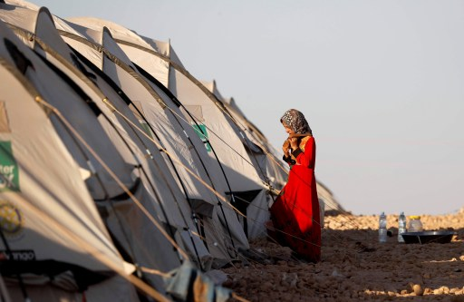 A girl walks towards her family's tent at a refugee camp for people displaced by fightings between the Syrian Democratic Forces and Islamic State militants in Ain Issa, Syria October 3, 2017.         REUTERS/Erik De Castro - RC182B251DD0