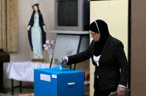 An Israeli Arab casts her ballot at a polling station inside a church in the northern town of Reineh March 17, 2015.  Prime Minister Benjamin Netanyahu faced a fight for his political survival on Tuesday as Israelis voted in an election that opinion polls predict the centre-left opposition could win. REUTERS/Ammar Awad (ISRAEL - Tags: POLITICS ELECTIONS) - GM1EB3I09JH01