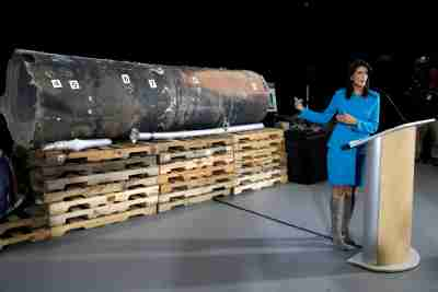 "U.S. Ambassador to the United Nations Nikki Haley briefs the media in front of remains of Iranian ""Qiam"" ballistic missile provided by Pentagon at Joint Base Anacostia-Bolling in Washington, U.S., December 14, 2017. REUTERS/Yuri Gripas - RC1784CD2850"