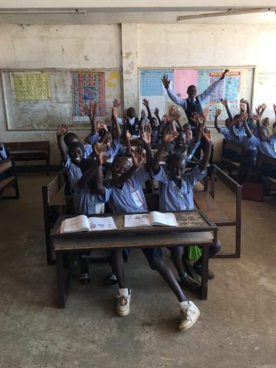Teacher and students at Abuko Lower Basic School