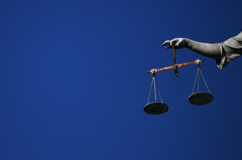 Balance scales are seen hanging from a statue in Dublin Castle in Dublin, Ireland October 15, 2018. REUTERS/Clodagh Kilcoyne - RC1991A87A10