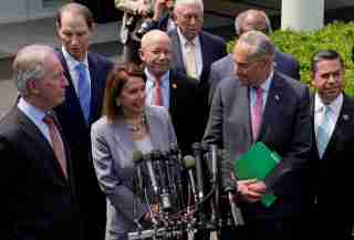 Senate Democratic Leader Chuck Schumer, U.S. House Speaker Nancy Pelosi and other congressional Democrats speak to reporters after their meeting on infrastructure with U.S. President Donald Trump at the White House in Washington, U.S., April 29, 2019.  REUTERS/Kevin Lamarque - RC134195ACF0