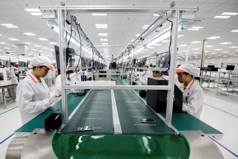 Manufacturers work at an assembly line of Vingroup's Vsmart phone in Hai Phong.