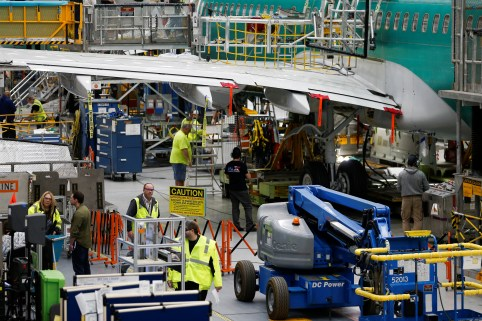 Employees work on several 737 Max aircrafts at the Boeing factory in Renton, Washington, U.S., March 27, 2019.  REUTERS/Lindsey Wasson - RC12CF24E470