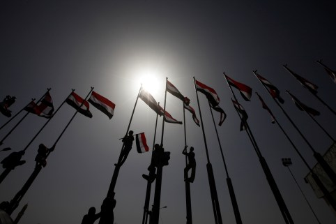 People climb flag poles flying Yemen's national flag during a ceremony marking Yemen's Reunification Day, in Sanaa, May 22 ,2016. REUTERS/Mohamed al-Sayaghi - S1BETFMQVRAB