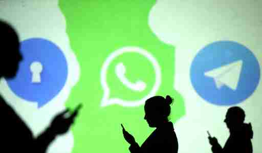 Silhouettes of mobile users are seen next to logos of social media apps Signal, Whatsapp and Telegram projected on a screen in this picture illustration taken March 28, 2018.  REUTERS/Dado Ruvic/Illustration - RC147CF8D300