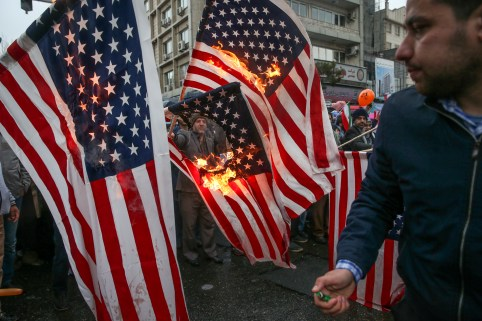 Iranians burn U.S. flags during a ceremony to mark the 40th anniversary of the Islamic Revolution in Tehran, Iran February 11, 2019. Meghdad Madadi/Tasnim News Agency/via REUTERS ATTENTION EDITORS - THIS PICTURE WAS PROVIDED BY A THIRD PARTY     TPX IMAGES OF THE DAY - RC1205408EB0