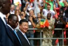 Senegal's President Macky Sall and Chinese President Xi Jinping enter the stadium during the opening ceremony of the Arene Nationale du Senegal in Dakar, Senegal July 22, 2018.  REUTERS/Mikal McAllister - RC1CB00541E0