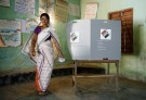 A woman leaves after casting her vote at a polling station during the first phase of general election in Majuli, a large river island in the Brahmaputra river, in the northeastern Indian state of Assam, India April 11, 2019. REUTERS/Adnan Abidi - RC11642136E0