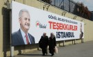 "DATE IMPORTED: April 01, 2019 People walk past by AK Party billboards with pictures of Turkish President Tayyip Erdogan and mayoral candidate Binali Yildirim in Istanbul, Turkey, April 1, 2019. The billboards read: "" Thank you Istanbul "". REUTERS/Huseyin Aldemir"