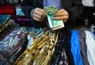 EDITORS' NOTE: Reuters and other foreign media are subject to Iranian restrictions on leaving the office to report, film or take pictures in Tehran.A shopkeeper counts Iranian bank notes at his shop in a bazar in Tehran February 25, 2012. REUTERS/Raheb Homavandi (IRAN - Tags: SOCIETY BUSINESS) - GM1E82Q02H301