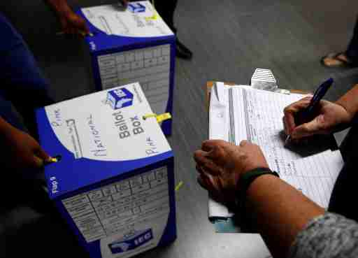 Election officials seal ballot boxes at the end of voting in South Africa's parliamentary and provincial elections at a polling station in Johannesburg, South Africa, May 8,2019. REUTERS/Philimon Bulawayo - RC197F6624B0
