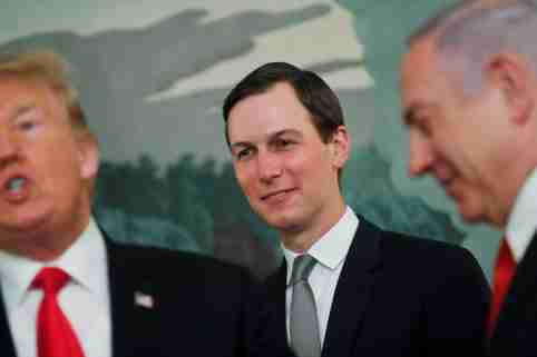 White House senior advisor Jared Kushner smiles while listening to U.S. President Donald Trump talk as the president meets with Israel's Prime Minister Benjamin Netanyahu at the White House in Washington, U.S., March 25, 2019. REUTERS/Carlos Barria     TPX IMAGES OF THE DAY - RC188FAA0870