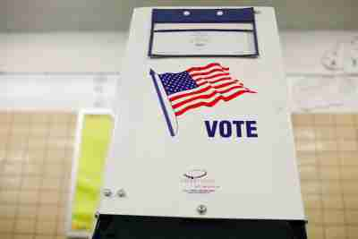 A voting booth is seen as voting opens for the midterm election at P.S. 140 in Manhattan, New York City, U.S., November 6, 2018. REUTERS/Andrew Kelly - RC134B64D810