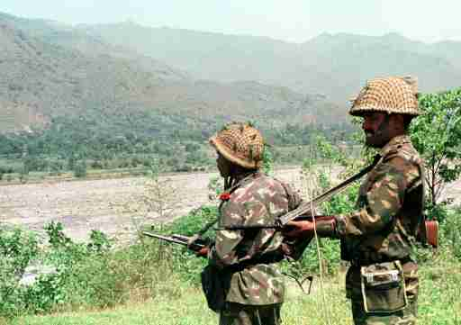FILE PHOTO 7MAY96 - Indian soldiers keep vigil at Degwar in strife-torn Kashmir which borders Pakistan in this file photo. India on Wednesday launched air strikes on its side of a ceasefire line to expel Pakistan-backed militants who infiltrated in Kashmir's Kargil sector. It also warned Pakistan's army and airforce not to interfere.KK/CC - RP1DRIIGLPAA