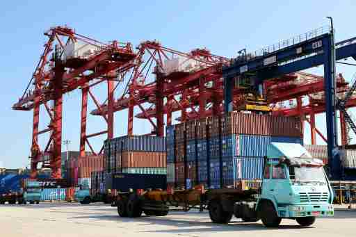 Shipping containers are seen at a port.