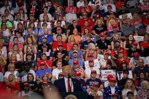Supporters of U.S. President Donald Trump look on as Trump speaks during a campaign rally in Cincinnati, Ohio, U.S., August 1, 2019.   REUTERS/Bryan Woolston - RC179FD13B60