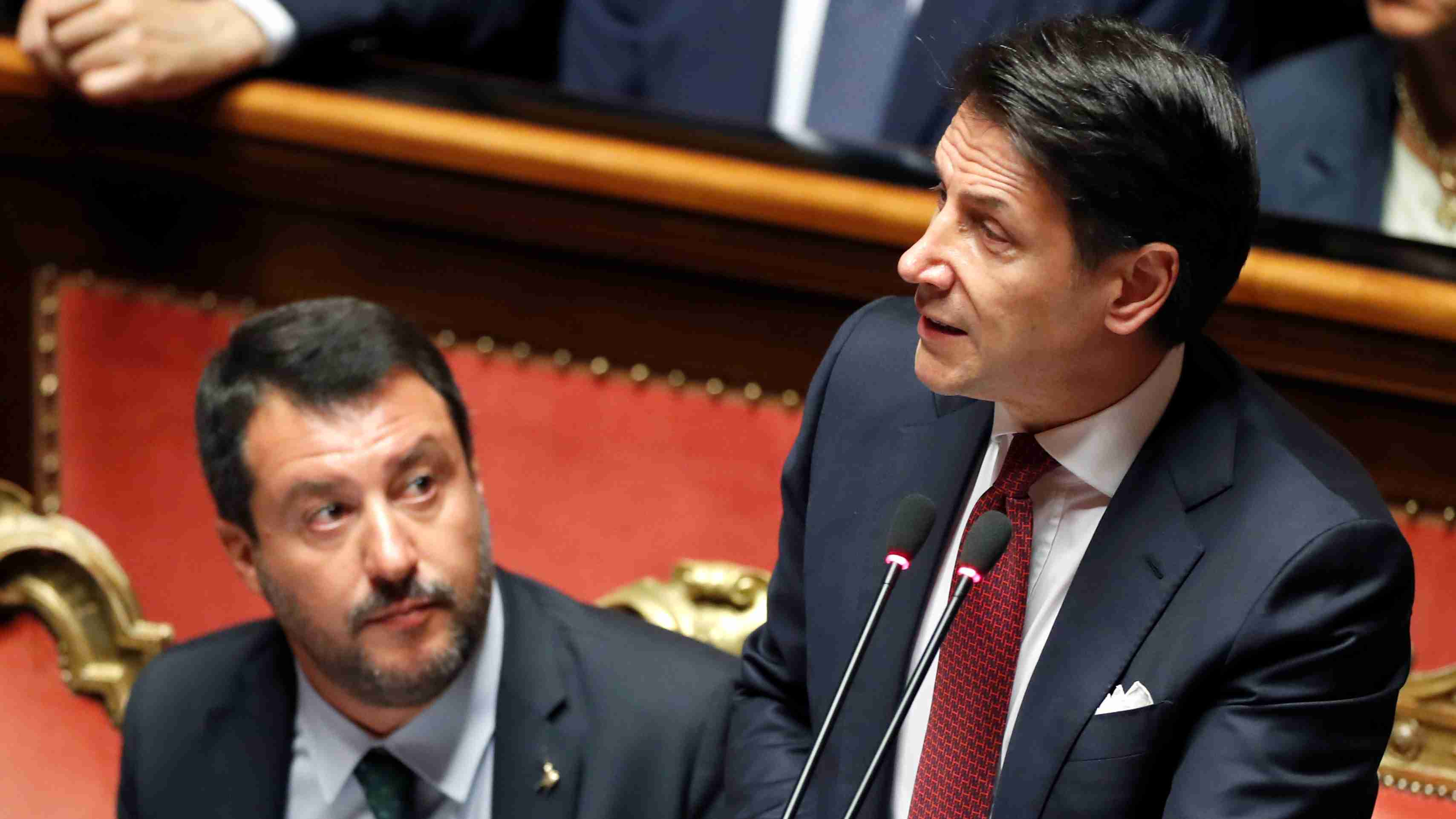 Italian Prime Minister Giuseppe Conte, next to Italian Deputy PM Matteo Salvini, addresses the upper house of parliament over the ongoing government crisis, in Rome, Italy August 20, 2019. REUTERS/Yara Nardi - RC17338CA110