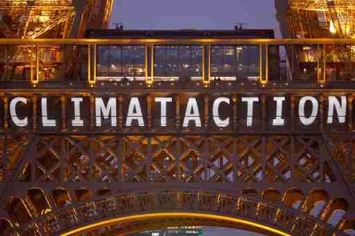"The slogan ""Climate action"" is projected on the Eiffel Tower as part of the World Climate Change Conference 2015 (COP21) in Paris, France, December 11, 2015.   REUTERS/Charles Platiau - LR1EBCB1BKV2N"