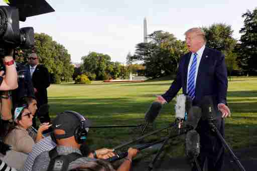 U.S. President Donald Trump speaks with reporters on the South Lawn of the White House in Washington, U.S., before his departure to Camp David, August 30, 2019. REUTERS/Yuri Gripas - RC1574057F20