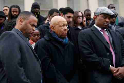 African-American Congressional staffers and representatives, including Representative Mark Veasey (D-TX) (L) and Elijah Cummings (D-MD) (C) stage a walk out on the steps of the House of Representatives at the U.S. Capitol to protest the deaths of Michael Brown and Eric Garner, in Washington December 11, 2014. REUTERS/Gary Cameron   (UNITED STATES - Tags: CRIME LAW POLITICS CIVIL UNREST) - GM1EACC0G0P01