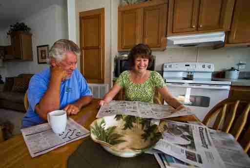 Mark Findlay and his wife Delores Findlay, of Erie, Pennsylvania, read the morning newspaper inside their home at Limetree Park where they spend the winter months in Bonita Springs, Florida, March 23, 2012. Medicare and Social Security, the massive programs that pay benefits to tens of millions of older Americans, are contentious issues in the 2012 presidential campaign. Seniors want the nation?s sputtering economy to be fixed, but not at their expense.   REUTERS/Steve Nesius  (UNITED STATES - Tags: ELECTIONS POLITICS SOCIETY) - TM3E846043F01