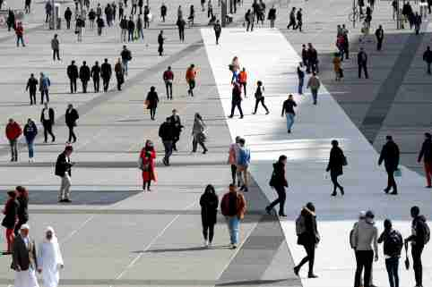 People walk on the esplanade of La Defense, in the financial and business district, west of Paris, France, October 6, 2017. REUTERS/Charles Platiau - RC1B9BB86D30