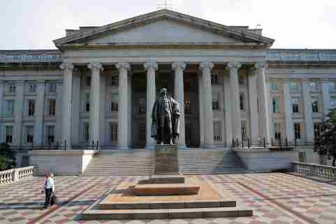 A man walks away from the U.S Treasury Department in Washington, U.S., August 6, 2018.     REUTERS/Brian Snyder - RC1FD03EA500