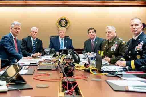 U.S. President Donald Trump, U.S. Vice President Mike Pence (2nd L), U.S. Secretary of Defense Mark Esper (3rd R), along with members of the national security team, watch as U.S. Special Operations forces close in on ISIS leader Abu Bakr al-Baghdadi, in the Situation Room of the White House in Washington, U.S., October 26, 2019. Picture taken October 26, 2019.  Shealah Craighead/The White House/Handout via REUTERS  THIS IMAGE HAS BEEN SUPPLIED BY A THIRD PARTY.     TPX IMAGES OF THE DAY - RC1CACE38AD0