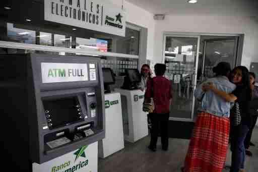 An automated teller machine (ATM) is seen in a bank in San Salvador, El Salvador April 4, 2019. REUTERS/Jose Cabezas - RC18A7449F80