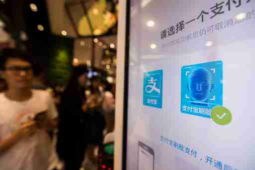 """Alipay's facial recognition payment solution """"Smile to Pay"""" is seen at KFC's new KPRO restaurant in Hangzhou, Zhejiang province, China September 1, 2017.  REUTERS/Stringer ATTENTION EDITORS - THIS IMAGE WAS PROVIDED BY A THIRD PARTY. CHINA OUT. NO COMMERCIAL OR EDITORIAL SALES IN CHINA. - RC13F17F7AA0"""