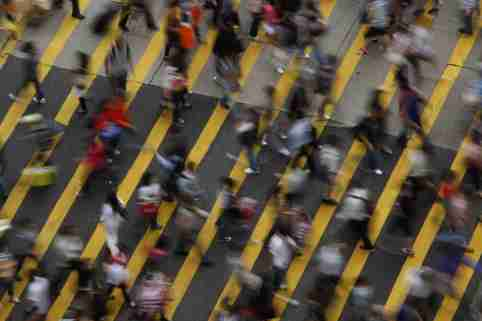 ATTENTION EDITORS - IMAGE 1 OF 22 OF PICTURE PACKAGE '7 BILLION, 7 STORIES - OVERCROWDED IN HONG KONG. SEARCH 'MONG KOK' FOR ALL IMAGES - People cross a street in Mong Kok district in Hong Kong, October 4, 2011. Mong Kok has the highest population density in the world, with 130,000 in one square kilometre. The world's population will reach seven billion on 31 October 2011, according to projections by the United Nations, which says this global milestone presents both an opportunity and a challenge for the planet. While more people are living longer and healthier lives, says the U.N., gaps between rich and poor are widening and more people than ever are vulnerable to food insecurity and water shortages.   Picture taken October 4, 2011.   REUTERS/Bobby Yip   (CHINA - Tags: SOCIETY) - LM2E7AE147B01