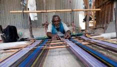 Abdulahi Abuker weaves threads into traditional garments, preserving a Somali tradition that is under threat from a flood of inexpensive clothes imported from China and other countries, in the Madina district of Mogadishu, Somalia.September 13, 2019.Picture taken September 13, 2019. REUTERS/Feisal Omar - RC1156B19070