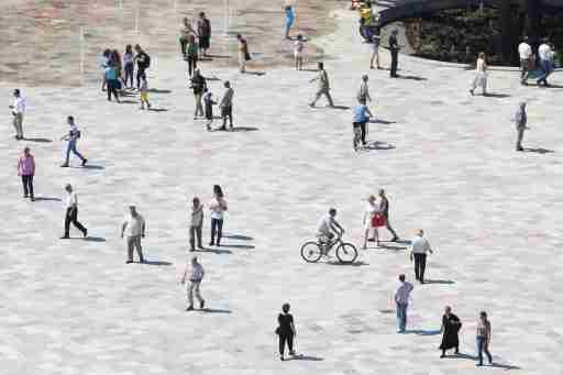 People walk on newly transformed Skenderbeg square in Tirana, Albania June 12, 2017. REUTERS/Florion Goga - RC1370A4B7C0