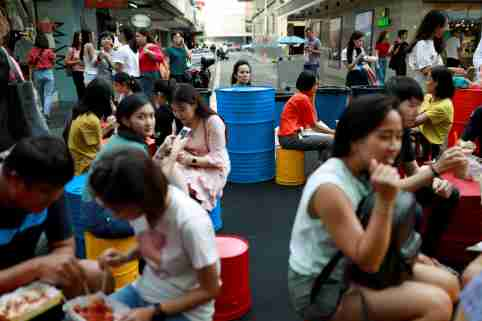 REFILE - CORRECTING STYLE People spend their time at a street food market in Bangkok, Thailand August 25, 2019. REUTERS/Soe Zeya Tun - RC1EAEB197C0