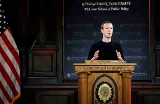 "Facebook Chairman and CEO Mark Zuckerberg addresses the audience on ""the challenges of protecting free speech while combating hate speech online, fighting misinformation, and political data privacy and security,"" at a forum hosted by Georgetown University's Institute of Politics and Public Service (GU Politics) and the McCourt School of Public Policy in Washington, U.S., October 17, 2019. REUTERS/Carlos Jasso - RC1CB9578F30"