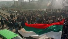 A Bulgarian flag blows in the breeze, as protesters block the main road between Sofia and the Greek border near Doupnitsa, 60 km south of the capital January 30. The angry citizens of Doupnitsa turned out in shifts in freezing cold to blockade road and rail routes to Greece for a second day, in protest against Bulgaria's Socialist rulers.BULGARIA BLOCKADE - RP1DRIDBQHAA