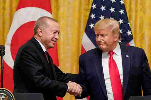 U.S. President Donald Trump greets Turkey's President Tayyip Erdogan during a joint news conference at the White House in Washington, U.S., November 13, 2019. REUTERS/Joshua Roberts - RC2MAD9Q8ACH