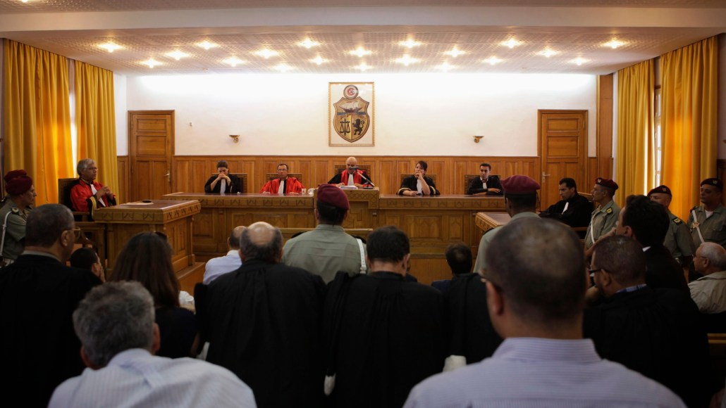 A general view of the trial is seen at a military court in Tunis July 19, 2012. Former Interior Minister Rafik Belhaj Kacem was sentenced to 15 years in jail and Ben Ali's security chief Ali Seriati was given 20 years over the killing of protesters in the capital Tunis and the towns of Sousse, Nabeul, Bizerte and Zaghouan as a popular uprising spread through the country early last year. Ben Ali fled with his family to Saudi Arabia. REUTERS/Zoubeir Souissi (TUNISIA - Tags: POLITICS CRIME LAW) - GM1E87J1QML01