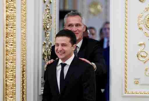 Ukrainian President Volodymyr Zelenskiy and NATO Secretary-General Jens Stoltenberg react while entering a hall following their talks in Kiev, Ukraine October 31, 2019. REUTERS/Gleb Garanich - RC178AF29120
