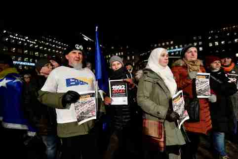 Protesters hold posters at a demonstration against the awarding of the 2019 Nobel literature prize to Peter Handke in Stockholm, Sweden December 10, 2019. TT News Agency/Stina Stjernkvist via REUTERS    THIS IMAGE HAS BEEN SUPPLIED BY A THIRD PARTY. SWEDEN OUT. NO COMMERCIAL OR EDITORIAL SALES IN SWEDEN - RC2JSD9XV83Q