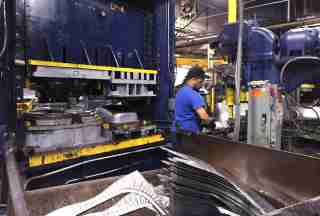 A production line employee works at the AMES Companies factory in Harrisburg, Pennsylvania.