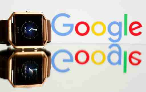 Fitbit Blaze watch is seen in front of a displayed Google logo in this illustration picture taken, November 8, 2019. REUTERS/Dado Ruvic - RC277D9CD9G0