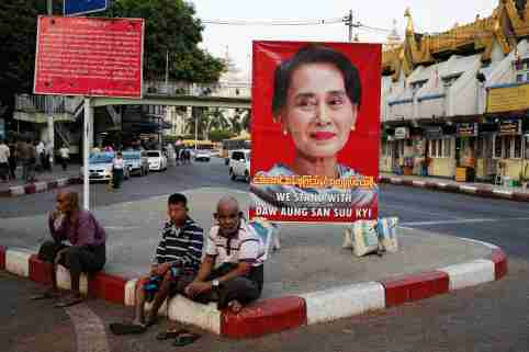 A poster supporting Aung San Suu Kyi as she attends a hearing at the International Court of Justice is seen in a road in Yangon, Myanmar, December 12, 2019. REUTERS/Ann Wang - RC2RTD98VHU5