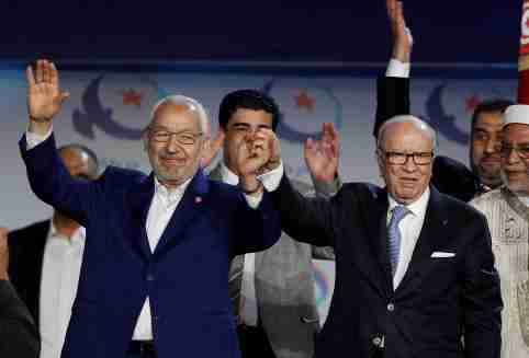 Tunisian President Beji Caid Essebsi (R) and Rached Ghannouchi, leader of the Islamist Ennahda movement, gesture during a congress of the Ennahda movement in Tunis,Tunisia May 20, 2016. Zoubeir Souissi